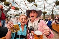 Tourists enjoying beer during Oktoberfest festival, Munich, Bavaria, Germany