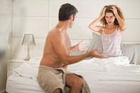 Couple arguing in bedroom