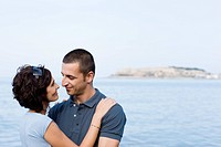 Couple hugging on waterfront