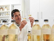 Scientist tasting whisky in plant