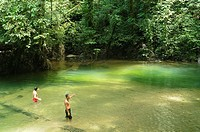 tourist enjoying a beautiful jungle pool in Mulu National Park in Sarawak, Borneo, Malaysia