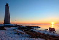 Five Mile Point Lighthouse, New Haven, CT at sunset, with snow on the ground.
