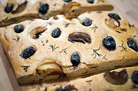 Home made olive bread with kalamata olives, caramelized onions and rosemary sprigs