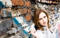 Pretty Woman Near Graffiti Wall