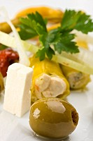 white plate with antipasti _ olives, tomatos and peperoni