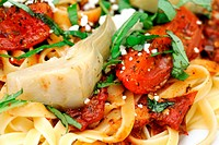 Close_up Fettuccini With Roasted Tomato And Basil