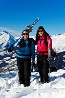 A skier and snowboarder having enjoying the mountains
