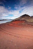 Red dirt road around a volcanic cone in Fjallabak Natural Reserve  Iceland