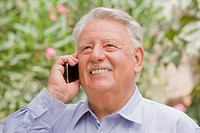 Senior Chilean man using cell phone
