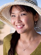 Asian woman in hat smiling