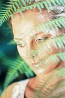 A face behind ferns, Bali.