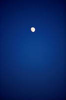 A moon on the dark blue sky.