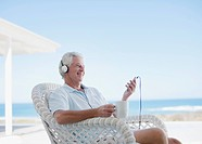 Senior man listening to mp3 player