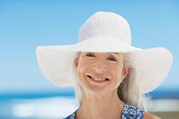 Close up of woman wearing sun hat