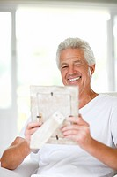 Senior man looking at picture frame