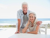 Senior couple at table on beach patio
