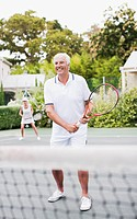 Senior couple playing tennis