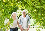 Senior couple walking in garden