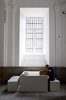 Visitor looking at catalogues, Museo Reina Sofia, Queen Sofia Museum, Madrid, Spain