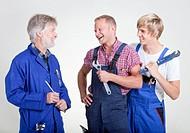 Three happy craftsmen of different age