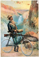 YELLOWSTONE PARK: RANGER.A park ranger standing on a mountain path beside his bicycle with a rifle fastened at sunset in Yellowstone National Park, Wy...