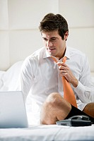 Relaxed Businessman Working in Hotel Room