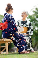 Mother and daughter wearing Yukata and talking