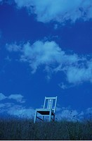 Chair on hill against cloudy sky. Mt Yatsugatake, Yamanashi Prefecture, Japan
