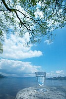 Glass of water on a table by a lake, Towada, Aomori Prefecture, Japan