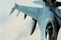 A KC_135 Stratotanker refueling an F_16CJ Fighting Falcon over Iraq.