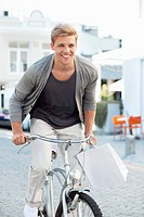 Smiling young man cycling