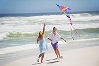 Couple flying kite on the beach
