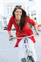Portrait of a beautiful young woman cycling (thumbnail)