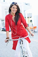 Portrait of a beautiful young woman cycling