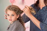 Mother styling her daughter´s hair