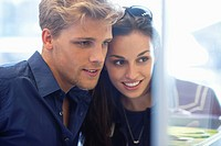 Young couple doing window shopping (thumbnail)