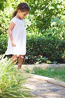 Little girl walking in the garden