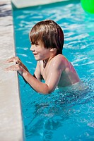 Boy smiling in a swimming pool