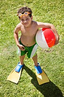 High angle view of a boy holding a beach ball