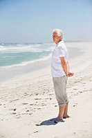 Side profile of a senior man standing on the beach