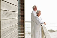 Senior couple standing at a balcony