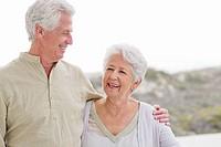 Senior man standing with his arm around a senior woman