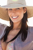 Portrait of a woman wearing sun hat and smiling
