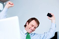 Cheering businessman in office