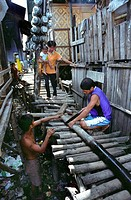PHILIPPINES. Cebu City.These families are too poor to buy homes inland with access to clean water. . They are forced to build makeshift houses along e...