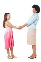 A full length portrait of grandmother holding hands with her granddaughter