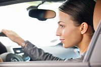 Young woman taking a test drive (thumbnail)