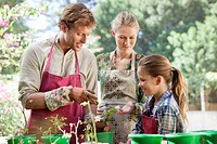 Parents and daughter gardening