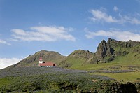 Church in field of lupins, Vik, Southern Iceland