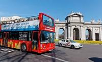 Double deck bus in front of Puerta de Alcala, Madrid, Spain